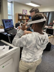 Summer STEAM Camp student experiments with virtual reality game.